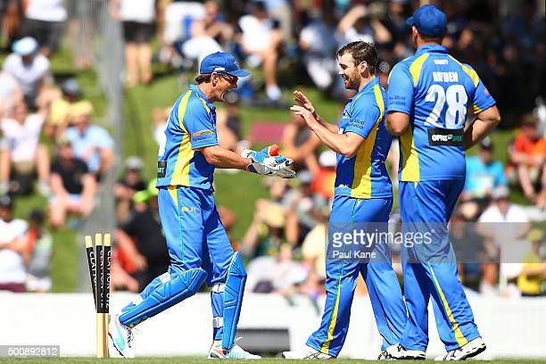 Adam Gilchrist and Ryan Duffield of the Legends celebrate a wicket during the WA Festival of Cricket Legends Match between the Australian Legends XI...