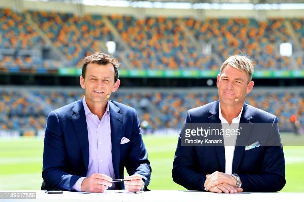 Adam Gilchrist and Shane Warne are seen during day four of the 1st Domain Test between Australia and Pakistan at The Gabba on November 24, 2019 in...