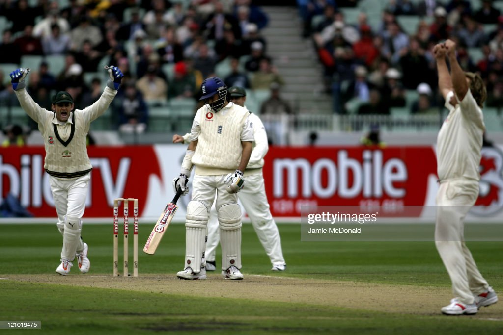 Adam Gilchrist and Shane Warne of Australia celebrate the dismissal of England in the First Innings in Day One of the Fourth Ashes Test at the Melbourne Cricket Ground, Australia, December 26, 2006. Australia leads the best of 5 series 3-0.