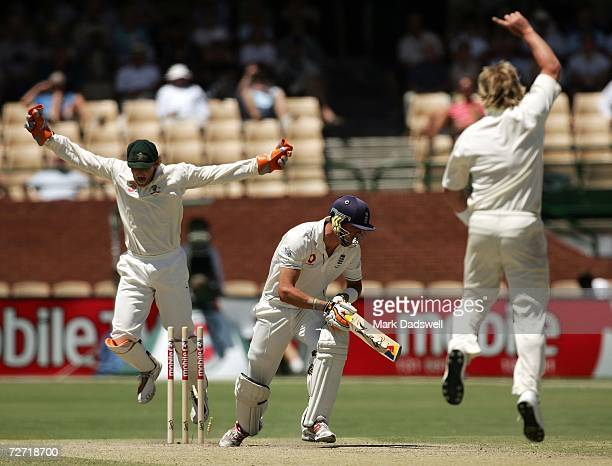 Adam Gilchrist and Shane Warne of Australia celebrate the dismissal of Kevin Pietersen of England during day five of the second Ashes Test Match...