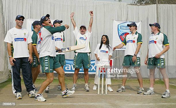 Adam Gilchrist and teammates Michael Bevan Andy Bichel Nathan Bracken Jimmy Maher Michael Kasprowicz and Brad Williams of Australia with Indian TV...
