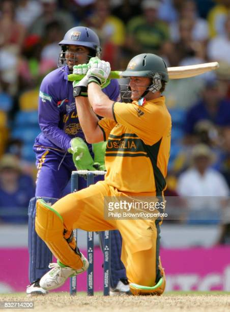 Adam Gilchrist batting Australia during his innings of 149 runs watched by Sri Lanka's wicketkeeper Kumar Sangakkara in the World Cup Final between...