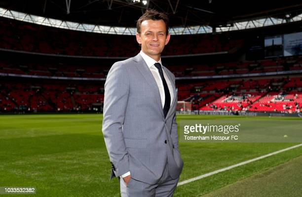 Adam Gilchrist, cricketer looks on pitchside prior to the Premier League match between Tottenham Hotspur and Liverpool FC at Wembley Stadium on...