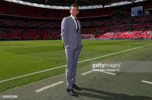 Adam Gilchrist cricketer looks on pitchside prior to the Premier League match between Tottenham Hotspur and Liverpool FC at Wembley Stadium on...
