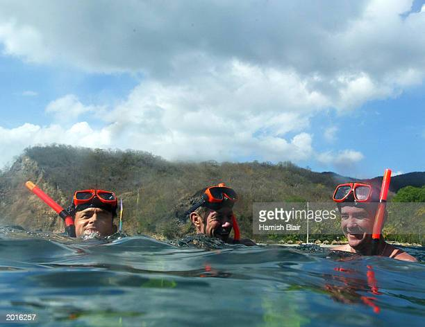 Adam Gilchrist John Buchanan and Jimmy Maher of Australia snorkel during a boat tour May 20 2003 in Castries St Lucia