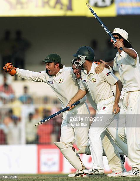 Adam Gilchrist, Justin Langer, Simon Katich and Jason Gillespie of Australia celebrate their team's win after day four of the Third Test between...