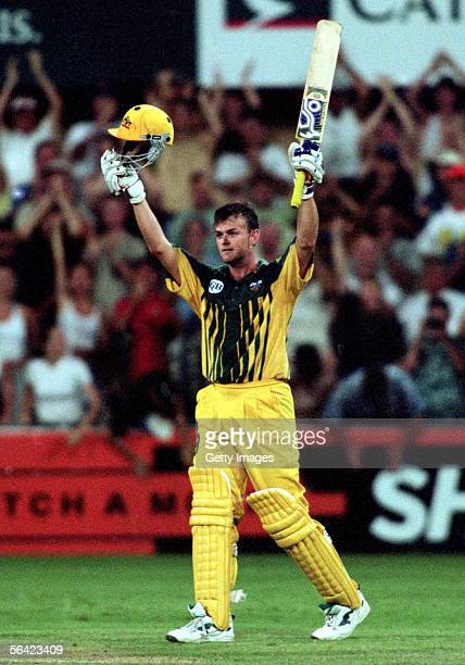 Adam Gilchrist of Australia celebrates reaching a century during a One Day International cricket match between Australia and South Africa held at the...