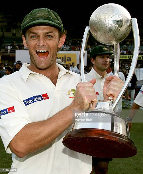 Adam Gilchrist of Australia celebrates with the Border Gavaskar Trophy after winning the series 2 - 1 with team mate Ricky Ponting looking on after...