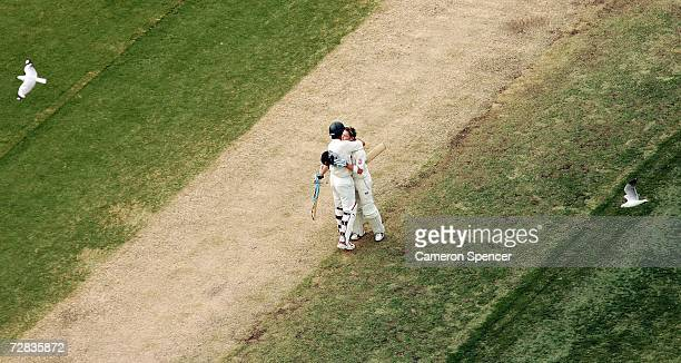 Adam Gilchrist of Australia congratulates teammate Michael Clarke after he reached his century during day three of the third Ashes Test Match between...