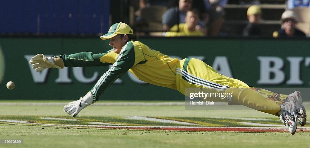 Adam Gilchrist of Australia dives after the ball during Game 7 of the VB Series between Australia and Sri Lanka played at the Adelaide Oval on January 26, 2006 in Adelaide, Australia.