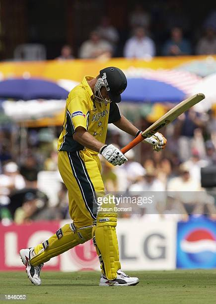 Adam Gilchrist of Australia heads back to the dressing room after being dismissed for 99 during the ICC Cricket World Cup 2003 Super Sixes match...