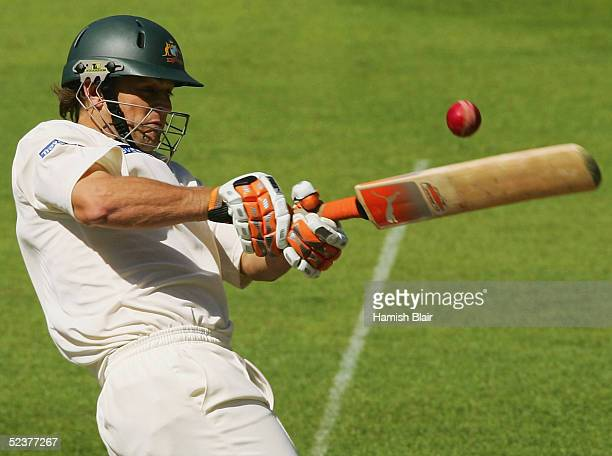 Adam Gilchrist of Australia hits a boundary during day three of the 1st Test between New Zealand and Australia played at Jade Stadium on March 12...