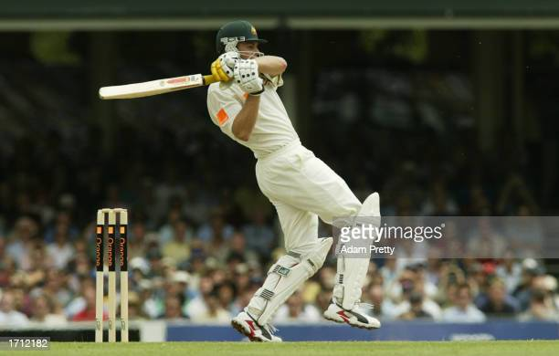 Adam Gilchrist of Australia hits one through the covers on his way to a century during the third day of the fifth Ashes Test between Australia and...