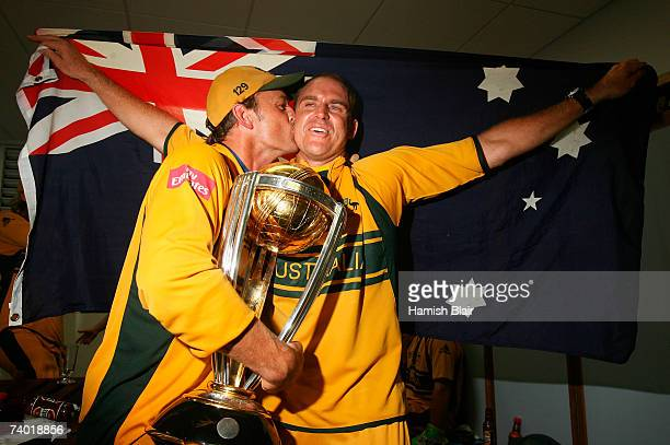 Adam Gilchrist of Australia kisses Matthew Hayden of Australia in the changing rooms after the ICC Cricket World Cup Final between Australia and Sri...