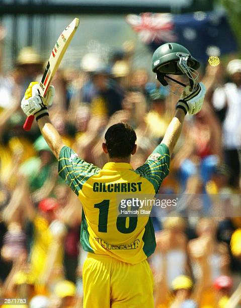 Adam Gilchrist of Australia reaches his century during the VB Series One Day International between Australia and Zimbabwe January 16 2004 at...