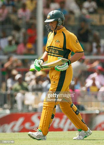 Adam Gilchrist of Australia walks back after being bowled by Charl Langeveldt of South Africa during the ICC Cricket World Cup Semi Final match...
