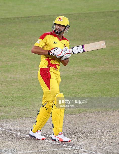 Adam Gilchrist of Sagittarius Strikers looks on after hitting a six during the Oxigen Masters Champions League match between Sagittarius Strikers and...