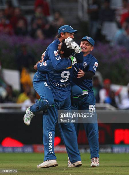 Adam Gilchrist of the Deccan Chargers congratultes RP Singh after taking the wicket of Chris Gayle of Kolkata during the IPL T20 match between Deccan...