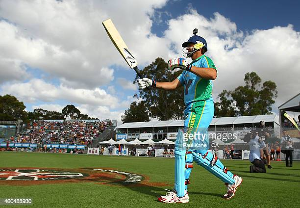 Adam Gilchrist of the Legends XI heads out to bat during the Twenty20 match between the Perth Scorchers and Australian Legends at Aquinas College on...