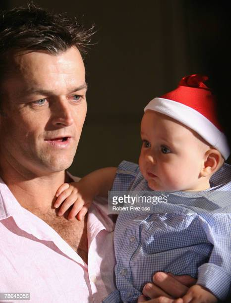 Adam Gilchrist with 10 month old Archie pose during the Australian cricket team Christmas lunch at Crown Casino on December 25 2007 in Melbourne...