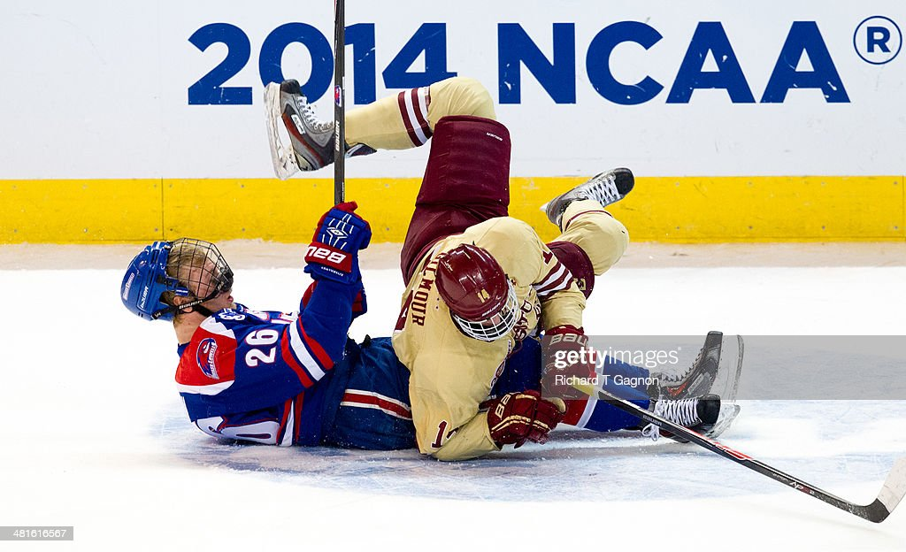 Adam Gilmour #14 of the Boston College Eagles collides with Christian Folin #26 of the Massachusetts Lowell River Hawks during the NCAA Division I Men's Ice Hockey Northeast Regional Championship Final at the DCU Center on March 30, 2014 in Worcester, Massachusetts.
