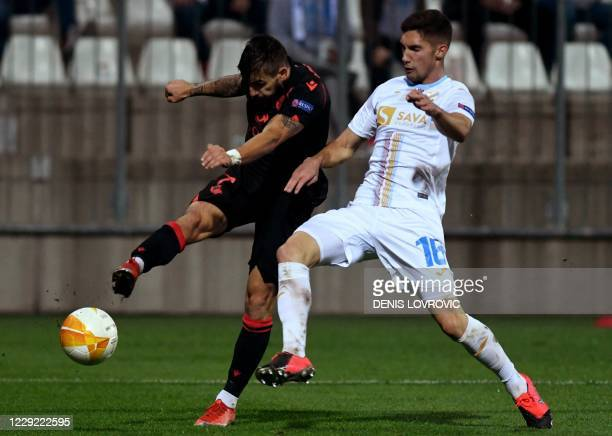 Adam Gnezda Cerim of HNK Rijeka vies with Cristian Portugues of the Real Sociedad during the UEFA Europa League Group F stage match between HNK...