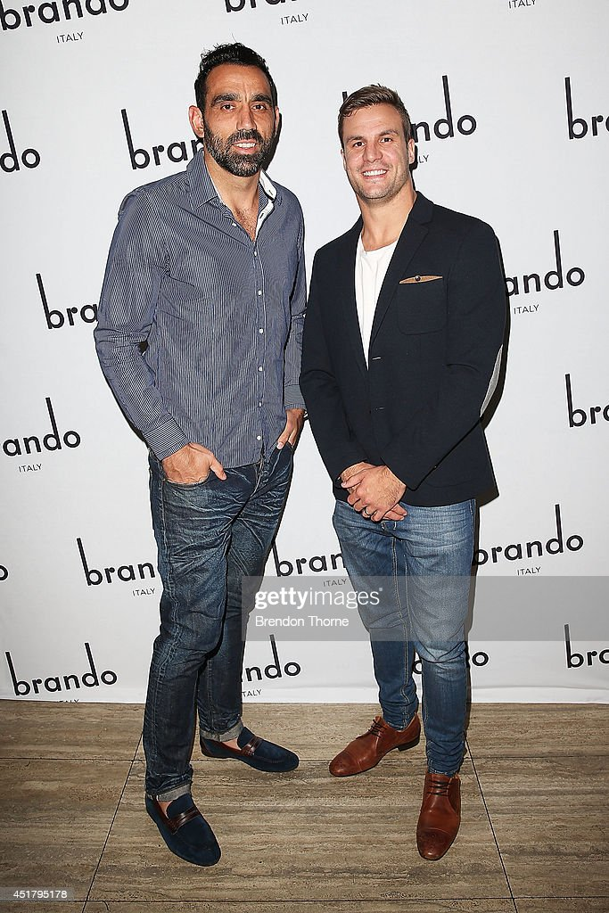 Adam Goodes and Beau Ryan arrive at the official Brando Shoes Exhibition at The Ivy on July 7, 2014 in Sydney, Australia.