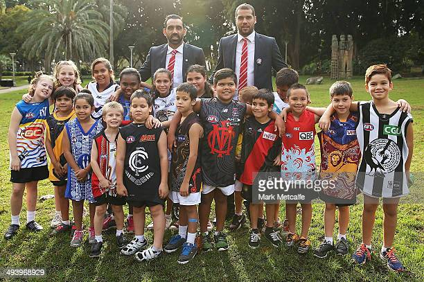 Adam Goodes and Lance Franklin of the Swans pose with young Indigenous participants from the AFL NSW program during the AFL Indigenous Round Launch...