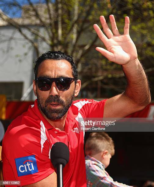 Adam Goodes of Sydney waves to the fans during the 2014 AFL Grand Final Parade on September 26 2014 in Melbourne Australia