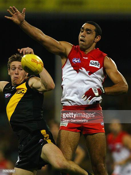 Adam Goodes of the Swans and Royce Vardy of the Tigers in action during the round 10 AFL match between the Richmond Tigers and the Sydney Swans on...