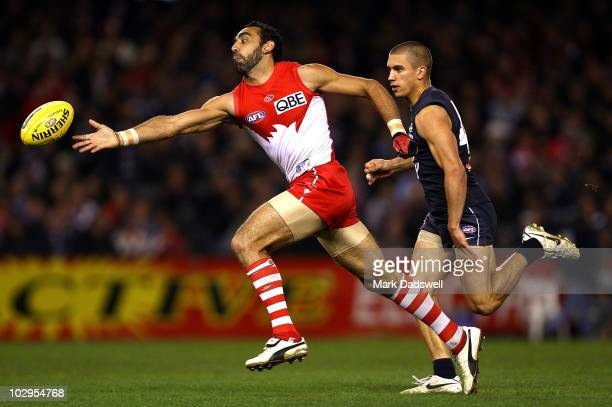 Adam Goodes of the Swans attempts to gather the ball under pressure from Andrew Carrazzo of the Blues during the round 16 AFL match between the...