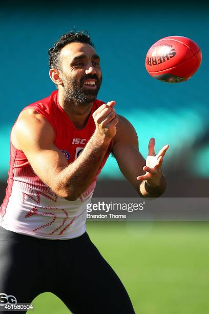 SYDNEY AUSTRALIA JULY Adam Goodes of the Swans hand passes to a team mate during a Sydney Swans AFL training session at Sydney Cricket Ground on July...