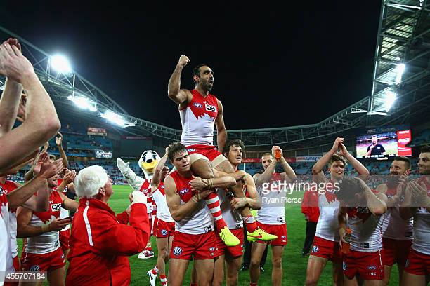 Adam Goodes of the Swans is chaired off after his 350th AFL match during the 1st Preliminary Final AFL match between the Sydney Swans and the North...