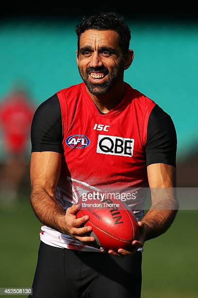Adam Goodes of the Swans shares a joke with a team mate during a Sydney Swans AFL training session at Sydney Cricket Ground on July 22 2014 in Sydney...