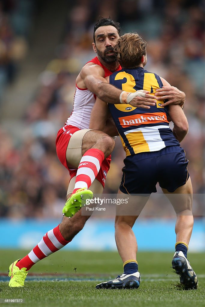 Adam Goodes of the Swans tackles Mark Hutchings of the Eagles during the round 17 AFL match between the West Coast Eagles and the Sydney Swans at Domain Stadium on July 26, 2015 in Perth, Australia.