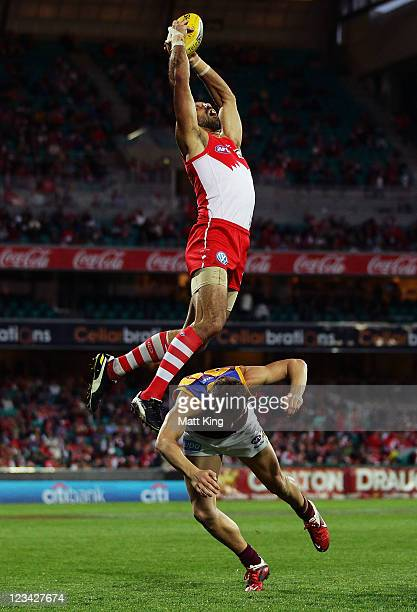 Adam Goodes of the Swans takes a mark over the top of Jack Redden of the Lions during the round 24 AFL match between the Sydney Swans and the...