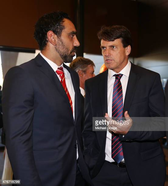 Adam Goodes of the Swans talks with coach Paul Roos of the Demons during the 2014 AFL Season Launch at Adelaide Oval on March 5, 2014 in Adelaide,...