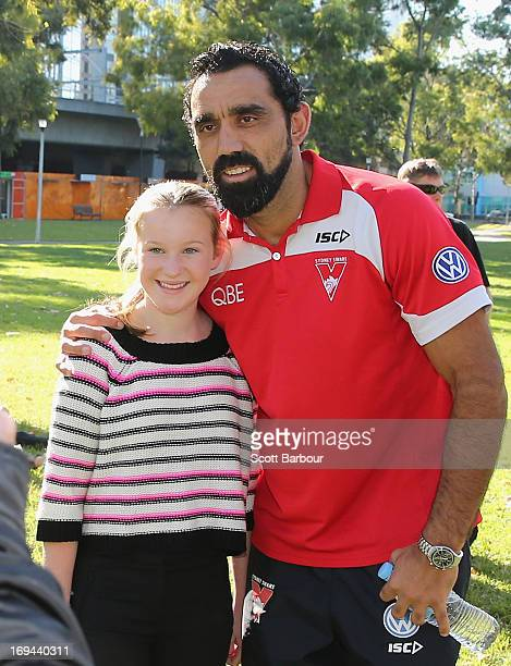 Adam Goodes of the Sydney Swans poses for a photo with a young girl after speaking to the media during an AFL press conference on May 25 2013 in...