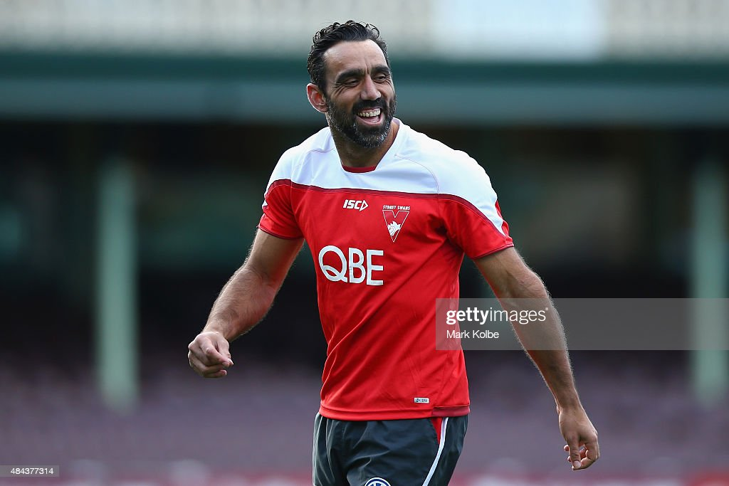 Adam Goodes shares a laugh with a team mate during a Sydney Swans AFL training session at Sydney Cricket Ground on August 18, 2015 in Sydney, Australia.