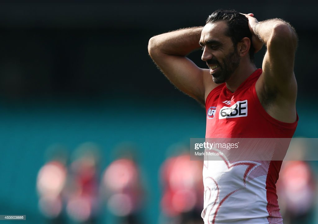 Adam Goodes smiles during a Sydney Swans AFL training session at Sydney Cricket Ground on August 12, 2014 in Sydney, Australia.