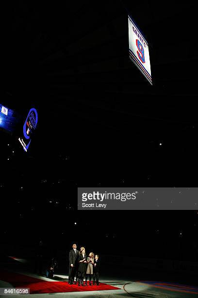 Adam Graves a former New York Ranger watches with his family as his jersey is raised to the rafters during a ceremony prior to a game between the New...