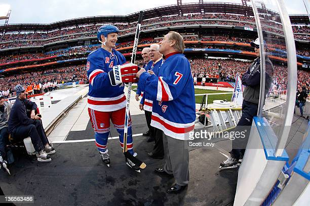 Adam Graves and ambassadors Harry Howell Ed Giacomin and Rod Gilbert of the New York Rangers prior to the game against the Philadelphia Flyers alumni...