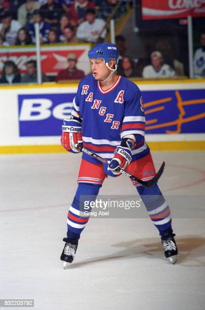 Adam Graves of the the New York Rangers watches the play against the Toronto Maple Leafs during NHL game action on October 14 1995 at Maple Leaf...