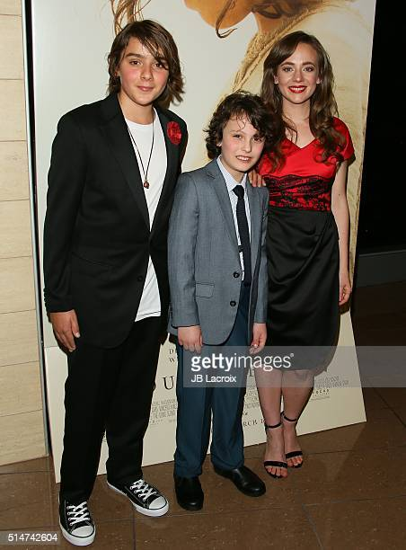 Adam Greaves Neal Finn McLeodIreland and Sara Lazzaro attend the screening of Focus Features' The Young Messiah on March 10 2016 in Los Angeles...