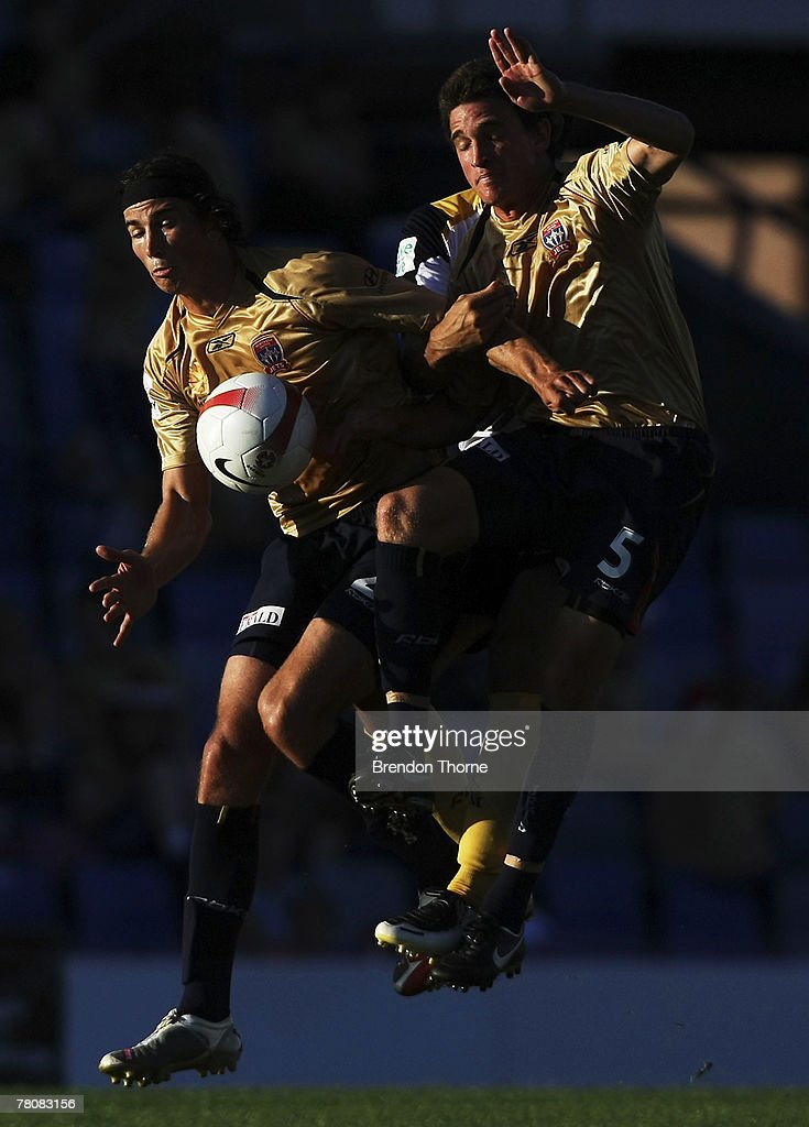 Adam Griffiths and team mate Stuart Musialik of the Jets collide during the round 14 A-League match between the Newcastle Jets and the Central Coast Mariners at EnergyAustralia Stadium on November 25, 2007 in Newcastle, Australia.