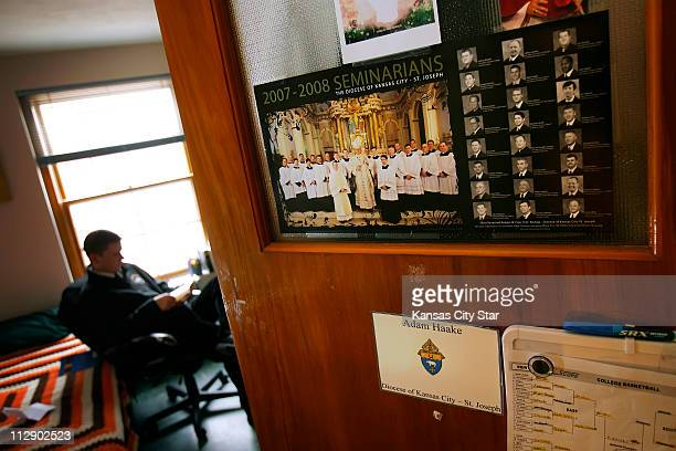 Adam Haake, a senior student at the Conception Seminary College in Conception, Mo., displays a seminarian poster on his residence hall room door from...