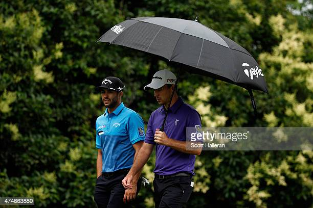 Adam Hadwin and Nick Taylor from Canada walk the fairway during the final round of the Crowne Plaza Invitational at the Colonial Country Club on May...