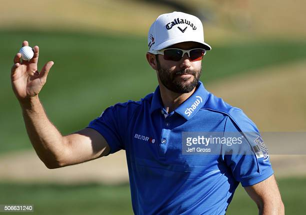 Adam Hadwin of Canada acknowledges the gallery after making birdie on the ninth hole during the final round of the CareerBuilder Challenge In...