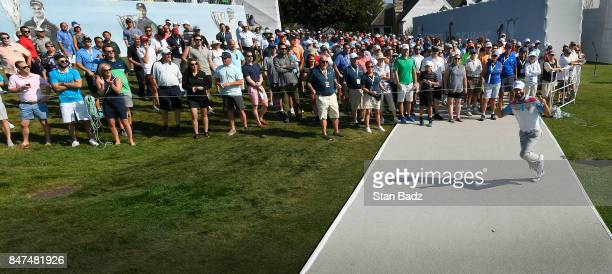 Adam Hadwin of Canada acknowledges the gallery on the first hole during the second round of the BMW Championship at Conway Farms Golf Club on...