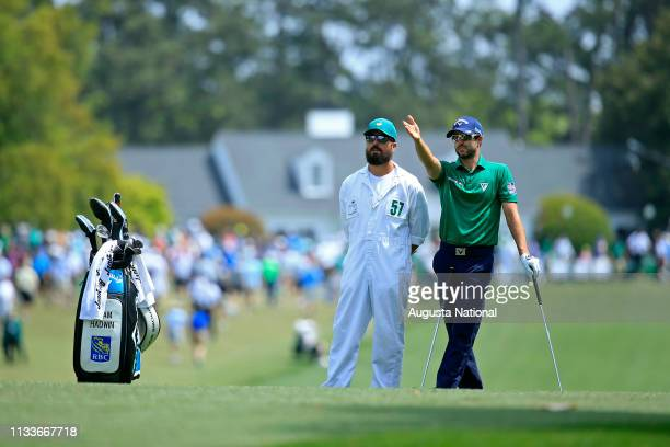Adam Hadwin of Canada and his caddie Joe Cruz look down Hole No 1 Fairway during the second round of the Masters at Augusta National Golf Club Friday...